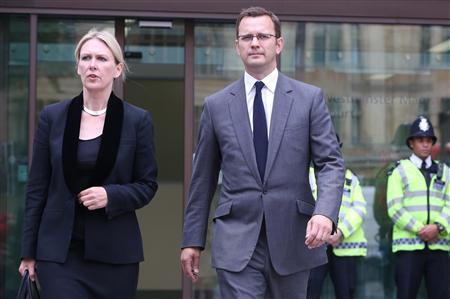 Former News of the World editor Andy Coulson (R) leaves after hearing charges of phone hacking at Westminster Magistrates Court in London August 16, 2012. REUTERS/Neil Hall (BRITAIN - Tags: CRIME LAW MEDIA)