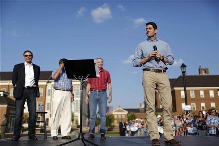 Republican vice presidential candidate Representative Paul Ryan (R-WI) (R) speaks at Miami University in Oxford, Ohio August 15, 2012. REUTERS/Aaron Bernstein
