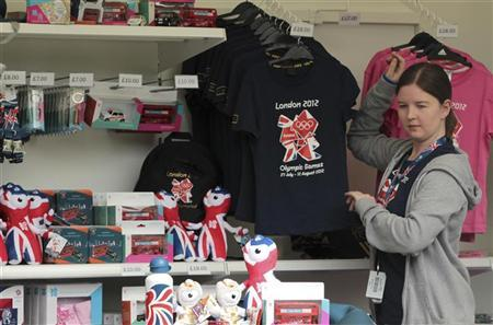A member of staff work in a London 2012 shop selling official merchandise in Green Park, central London, July 21, 2012. REUTERS/Olivia Harris