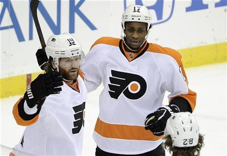 Philadelphia Flyers' Scott Hartnell (L) celebrates with teammates Wayne Simmonds (C) and Claude Giroux after scoring on the New Jersey Devils during the first period in Game 4 of their NHL Eastern Conference semi-final playoff hockey game in Newark, New Jersey, May 6, 2012. REUTERS/Ray Stubblebine