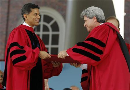 Journalist and writer Fareed Zakaria (L) receives an honorary Doctor of Laws degree from Marc Goodheart, Secretary of the Harvard Corporation, during the 361st Commencement Exercises at Harvard University in Cambridge, Massachusetts May 24, 2012. REUTERS/Brian Snyder