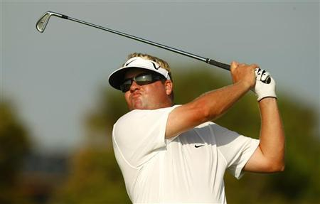 Carl Pettersson of Sweden watches his tee shot on the 14th hole during the weather delayed conclusion of the third round of the PGA Championship golf tournament at The Ocean Course on Kiawah Island, South Carolina, August 12, 2012. REUTERS/Chris Keane