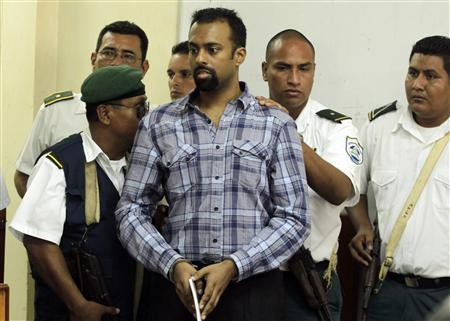 U.S citizen Jason Zachary Puracal is escorted by police during his arrival for his court appearance in Granada City, some 45 km (28 miles) south of Managua August 16, 2012. REUTERS/Oswaldo Rivas