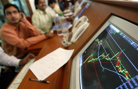 Stock brokers are seen at a brokerage firm in Mumbai May 13, 2004. REUTERS/Punit Paranjpe/Files