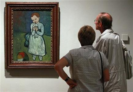 People look at the Picasso painting 'Child with a Dove' while it is displayed during the Picasso and Modern British Art exhibition at the National Gallery of Modern Art in Edinburgh, Scotland August 17, 2012. REUTERS/David Moir