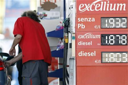 Signboards display fuel prices at a petrol station in Santa Severa, north of Rome, August 10, 2012. REUTERS/Giampiero Sposito
