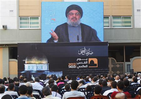 Lebanon's Hezbollah leader Sayyed Hassan Nasrallah addresses his supporters via a screen, during a rally marking ''Quds (Jerusalem) Day'',in the southern suburbs of Beirut, August 17, 2012. REUTERS/Sharif Karim