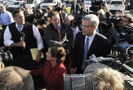Former Penn State Athletic Director Tim Curley walks through the press after his arraignment on perjury charges in Harrisburg, Pennsylvania, November 7, 2011. Curley is charged with perjury in the Grand Jury investigation of former Penn State Football Defensive Coordinator Jerry Sandusky. REUTERS/Pat Little