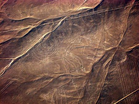 The geoglyph of a monkey is seen on the plains of the Nazca desert in southern Peru in this handout from June 2009. REUTERS/Carolina Castellanos/World Monuments Fund/Handout