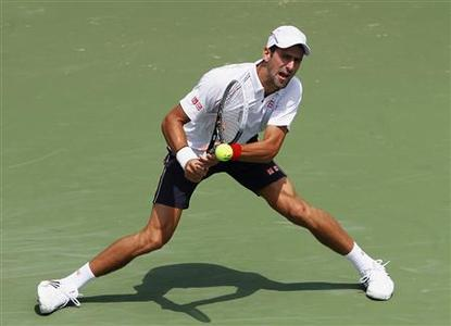 Novak Djokovic of Serbia hits a return shot to Marin Cilic of Croatia during their quarter final round match in the Cincinnati Open tennis tournament in Cincinnati, Ohio, August 17, 2012. REUTERS/John Sommers II