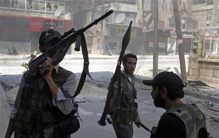 Free Syrian Army fighters hold their weapons during clashes in the Salaheddine neighbourhood of central Aleppo August 17, 2012. REUTERS/Goran Tomasevic
