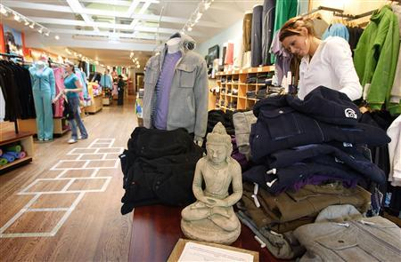 A Buddha statue sits at the entrance of Lululemon Athletic in San Francisco, California, in this March 31, 2006 file photo. REUTERS/Kimberly White/Files