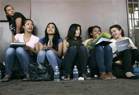 Students wait in line for assistance with paperwork for the Deferred Action for Childhood Arrivals program at the Coalition for Humane Immigrant Rights of Los Angeles in Los Angeles, California, August 15, 2012. REUTERS/Jonathan Alcorn