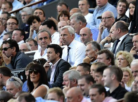Newcastle United's coach Alan Pardew (C) watches from the stand after being sent off during their Premier League match against Tottenham Hotspur at St James' Park in Newcastle, northern England August 18, 2012. REUTERS/Nigel Roddis
