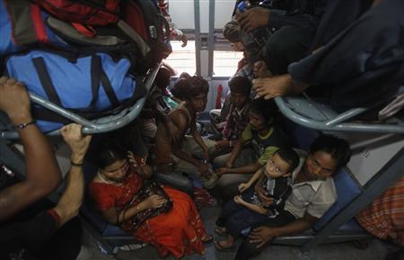 People from India's northeastern states sit inside a train bound for the Assam state at the railway station in Kolkata August 18, 2012. REUTERS/Rupak De Chowdhuri