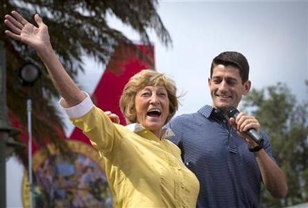 Republican vice presidential candidate Paul Ryan (R) introduces his mother Betty Douglas at a campaign event at The Villages in Lady Lake, Florida August 18, 2012. REUTERS/Scott Audette