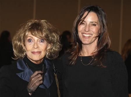 Veronique Peck (L), widow of actor Gregory Peck, and her daughter, actress and filmmaker Cecilia Peck, pose at a screening celebrating the 50th anniversary of the Academy Award winning film ''To Kill A Mockingbird'' at the Academy of Motion Picture Arts & Sciences in Beverly Hills, California, in this file April 11, 2012 photo. REUTERS/Fred Prouser