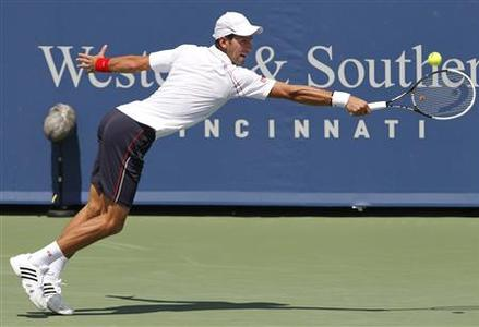 Novak Djokovic of Serbia hits a return to Juan Martin Del Potro of Argentina in their men's singles semi-final match at the Cincinnati Open tennis tournament in Cincinnati, Ohio August 18, 2012. REUTERS/John Sommers II