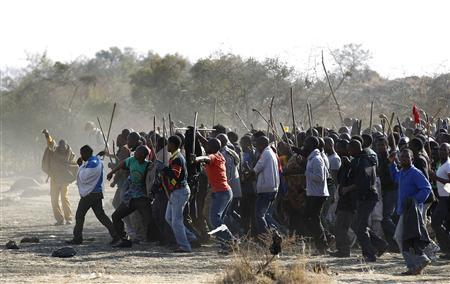 Striking miners march after they were addressed by former African National Congress Youth League (ANCYL) President Julius Malema outside a South African mine in Rustenburg, 100 km (62 miles) northwest of Johannesburg August 18, 2012. The bloody protest by South African miners that ended in a hail of police gunfire and 34 deaths this week could also wound the ruling ANC and its main labour ally, laying bare workers' anger over enduring inequalities in Africa's biggest economy. Thursday's shooting, bringing back memories of apartheid-era violence, underlined that after 18 years in power the African National Congress and its union partner have not been able to heal the fissures of income disparity, poverty and joblessness scarring the country. REUTERS/Siphiwe Sibeko