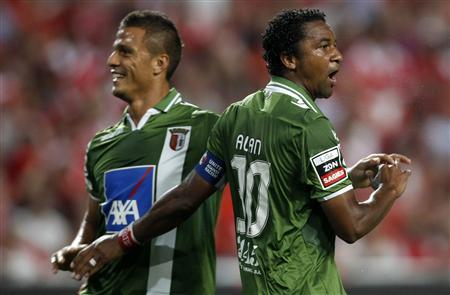 Braga's Lima (L) and Alan celebrate their goal against Benfica during their Portuguese Premier League match at Luz stadium in Lisbon August 18, 2012. REUTERS/Jose Manuel Ribeiro