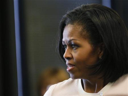 U.S. First Lady Michelle Obama talks to staff who treated victims of the July 20 Colorado movie theater shooting at the Medical Center of Aurora in Aurora, Colorado August 11, 2012. REUTERS/Rick Wilking