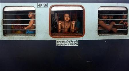 People from India's northeastern states sit inside a train bound for Assam at the railway station in Kolkata August 18, 2012. REUTERS/Rupak De Chowdhuri