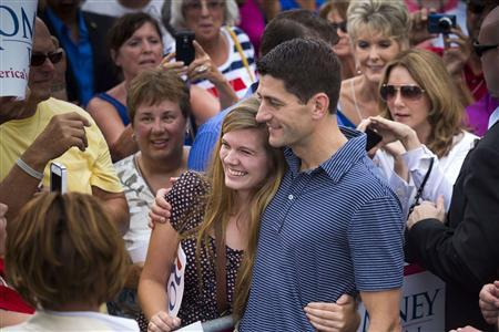 Republican vice presidential candidate Paul Ryan (R) works the rope line during during a campaign event at The Villages in Lady Lake, Florida August 18, 2012. REUTERS/Scott Audette
