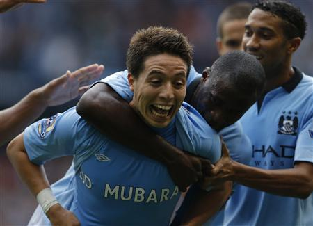 Manchester City's Samir Nasri (L) celebrates with Yaya Toure after scoring his side's third goal during their English Premier League soccer match against Southampton at the Etihad Stadium, northern England, August 19, 2012. REUTERS/Phil Noble