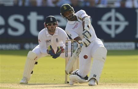 South Africa's Vernon Philander hits a six watched by England's Matt Prior (left) during the third cricket test match at Lord's in London August 19, 2012. REUTERS/Philip Brown