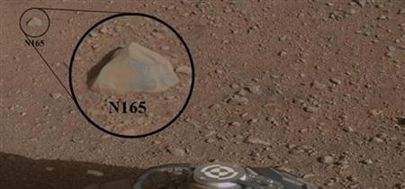 This mosaic image with a close-up inset, taken prior to the test, shows the rock chosen as the first target for NASA's Curiosity rover to zap with its Chemistry and Camera (ChemCam) instrument, on Mars in this Nasa handout photo. REUTERS/NASA/JPL-Caltech/MSSS/LANL/Handout