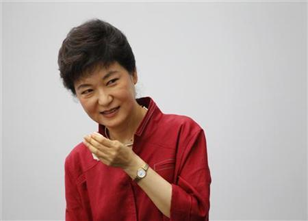 Park Geun-hye, lawmaker of the ruling Saenuri Party, wipes the sweat off her face after her speech during an event to launch her bid to become president in Seoul July 10, 2012. REUTERS/Lee Jae-Won