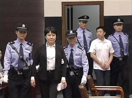 Gu Kailai (2nd L), wife of ousted Chinese Communist Party Politburo member Bo Xilai, and Zhang Xiaojun (2nd R), are escorted into the court room for trial at Hefei Intermediate People's Court in this still image taken from video August 9, 2012. REUTERS/CCTV via Reuters TV