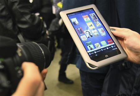 The new Nook Tablet is seen during a demonstration at the Union Square Barnes & Noble in New York, November 7, 2011. Barnes & Noble Inc. introduced its first ever tablet on Monday for $249 to compete for holiday tablet sales. REUTERS/Shannon Stapleton