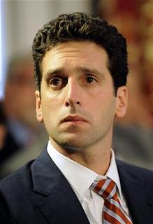 Superintendent of the Department of Financial Services Benjamin Lawsky listens to New York Governor Andrew M. Cuomo speak during a cabinet meeting in Albany, New York October 12, 2011. REUTERS/Hans Pennink