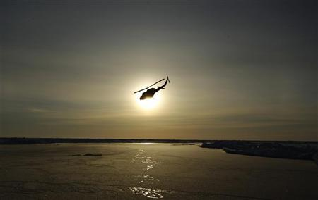 A helicopter flies over Arctic ice towards the Applied Physics Laboratory Ice Station (APLS) during an exercise near the 2011 APLS camp north of Prudhoe Bay, Alaska, in this March 18, 2011 picture. REUTERS/Lucas Jackson