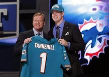 Ryan Tannehill from Texas A&M University holds up a jersey as he stands with NFL Commissioner Roger Goodell after being selected by the Miami Dolphins as the eighth overall pick in the 2012 NFL Draft in New York, April 26, 2012. REUTERS/Shannon Stapleton