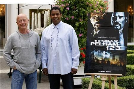 Director Tony Scott (L) and U.S. actor Denzel Washington pose during a photocall to promote the film ''The Taking of Pelham 123'' in Paris July 20, 2009. REUTERS/Benoit Tessier/Files