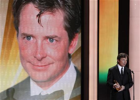 U.S. actor Michael J. Fox holds his international lifetime achievement award during the 46th 'Goldene Kamera' (Golden Camera) awards ceremony at the Ullstein Auditorium in Berlin, February 5, 2011. REUTERS/Tobias Schwarz