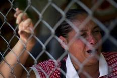 A relative of inmate cries outside Yare prison in San Francisco de Yare, 72 km (45 miles) south from Caracas, August 20, 2012. REUTERS/Carlos Garcia Rawlins