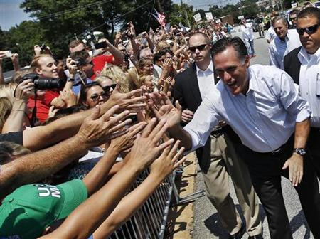 Republican U.S. presidential candidate Mitt Romney shakes hands with supporters outside a campaign stop in High Point, North Carolina August 12, 2012. REUTERS/Shannon Stapleton