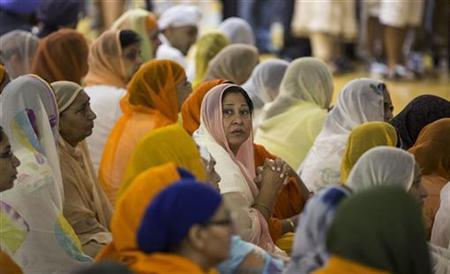 Family members and mourners gather during a wake and visitation service for victims of last Sunday's attack at a Sikh temple, at Oak Creek High School, in Oak Creek, Wisconsin August 10, 2012. REUTERS/Tom Lynn