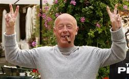 "Director Tony Scott poses during a photocall in Paris in this July 20, 2009 file photo. Hollywood filmmaker Scott, director of such big-screen action hits as ""Top Gun"" and ""Crimson Tide,"" jumped to his death on August 19, 2012 from a bridge over Los Angeles Harbor, the Los Angeles County Coroner's Office said. REUTERS/Benoit Tessier/Files"