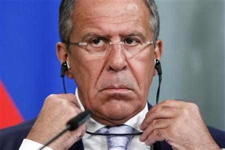 Russian Foreign Minister Sergei Lavrov, accompanied by his counterpart from Cyprus Erato Kozakou-Marcoullis, attends a news conference in Moscow, July 25, 2012. REUTERS/Maxim Shemetov/Files