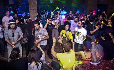 People dance to the beat of the house music at Centrifuge, a Pakistani underground rave party at a farmhouse on the outskirts of Pakistan's capital, Islamabad early July 15, 2012. REUTERS/Stringer