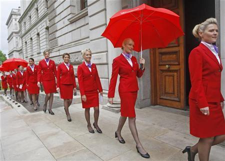 File photo of Virgin Atlantic Cabin Crew walking past the Treasury in London, June 16, 2011. REUTERS/Luke MacGregor/Files.