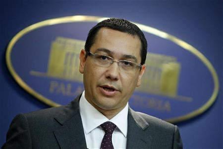 Romania's Prime Minister Victor Ponta addresses media after a meeting with an International Monetary Fund mission to review the country's progress in meeting the terms of its aid package, at Victoria palace in Bucharest August 8, 2012. REUTERS/Bogdan Cristel