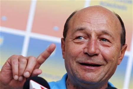 Romania's suspended President Traian Basescu addresses the media in Bucharest August 9, 2012. REUTERS/Bogdan Cristel