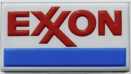 The Exxon corporate logo is pictured at one of the company's gas stations in Arlington, Virginia, August 10, 2011. REUTERS/Jason Reed