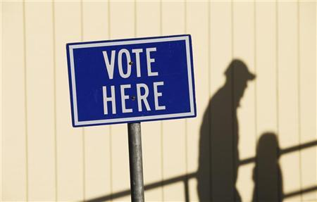 A voter arrives at a polling location to vote in Portland, Maine November 3, 2009. REUTERS/Joel Page
