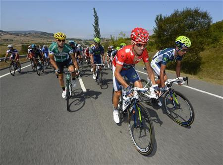 Movistar Team rider Alejandro Valverde of Spain (C) cycles during the fourth stage of the Tour of Spain ''La Vuelta'' cycling race between Barakaldo and Estacion de Valdezcaray August 21, 2012. REUTERS/Felix Ordonez